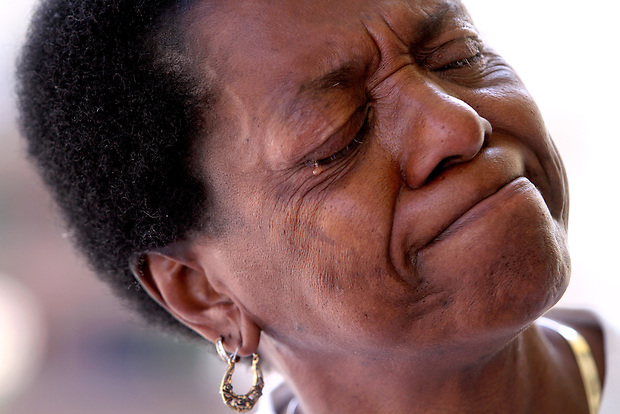 """Cheryl Cook of Des Moines sheds a tear while recounting the horror of Hurricane Katrina five years ago.  """"It was like the world was coming to an end,"""" said Cook, who was trapped in the attic of her New Orleans home for days before being rescued from flood waters that had enveloped her house."""