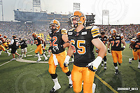 September 7, 2009; Hamilton, ON, CAN; Hamilton Tiger-Cats offensive lineman Marwan Hage (62) offensive lineman Simeon Rottier (65). CFL football - the Labour Day Classic - Toronto Argonauts vs. Hamilton Tiger-Cats at Ivor Wynne Stadium. The Tiger-Cats defeated the Argos 34-15. Mandatory Credit: Ron Scheffler.