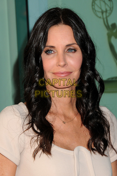 """COURTENEY COX.An Evening With """"Cougar Town"""" held at the Academy Of Television Arts & Sciences, North Hollywood, California, USA, 20th April 2011..portrait headshot cream nude  wavy hair beauty .CAP/ADM/BP.©Byron Purvis/AdMedia/Capital Pictures."""