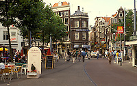 AJ2167, Amsterdam, Holland, Netherlands, Europe, Outdoor cafes and shops along the street in downtown Amsterdam.