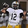 Massapequa quarterback No. 12 Brad Baldinger throws for a first down during a Nassau County Conference I varsity football game against host Freeport High School on Friday, September 25, 2015<br /> <br /> James Escher