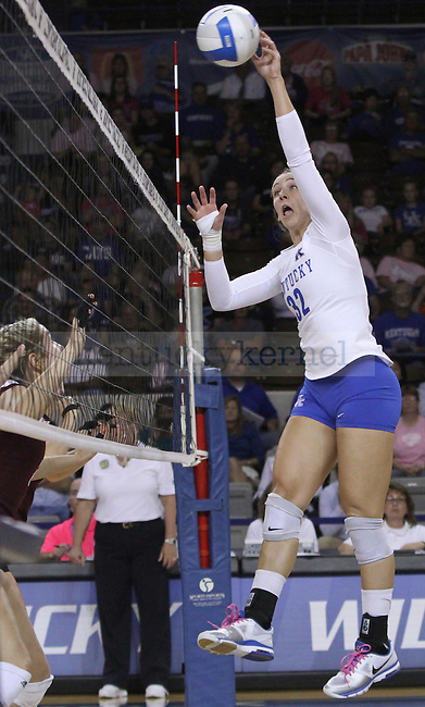 Senior Setter Christine Hartmann (22) tips the ball over the net during the University of Kentucky vs. Texas A&M volleyball match at Memorial Coliseum in Lexington, Ky., on Sunday, October 14, 2012. Photo by Jared Glover | Staff
