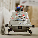 8 January 2016: Donghyun Kim, piloting his 2-man bobsled for South Korea, enters the Chicane straightaway on his second run, ending the day with a combined 2-run time of 1:51.90 and earning a 15th place finish at the BMW IBSF World Cup Championships at the Olympic Sports Track in Lake Placid, New York, USA. Mandatory Credit: Ed Wolfstein Photo *** RAW (NEF) Image File Available ***
