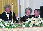 United States President Bill Clinton, left, converses with former U.S. President George H.W. Bush, right, as former first lady Lady Bird Johnson, center, looks on at the 200th  Anniversary of the White House dinner in the East Room in Washington, DC on November 9, 2000. <br /> Credit: Ron Sachs / CNP