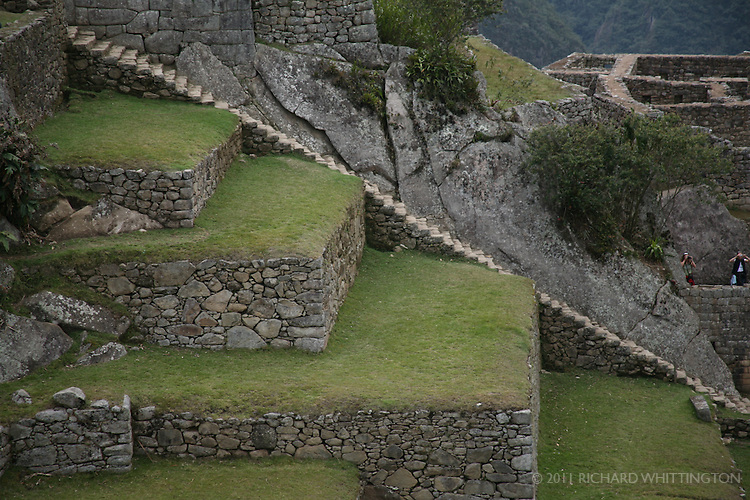 Terraces and staircases are scattered across the Incan ruins at Machu Pichu.