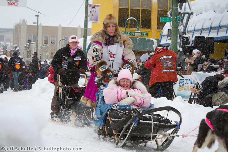 DeeDee Jonrowe leaves the 2011 Iditarod ceremonial start line in downtown Anchorage, during the 2012 Iditarod..Jim R. Kohl/Iditarodphotos.com