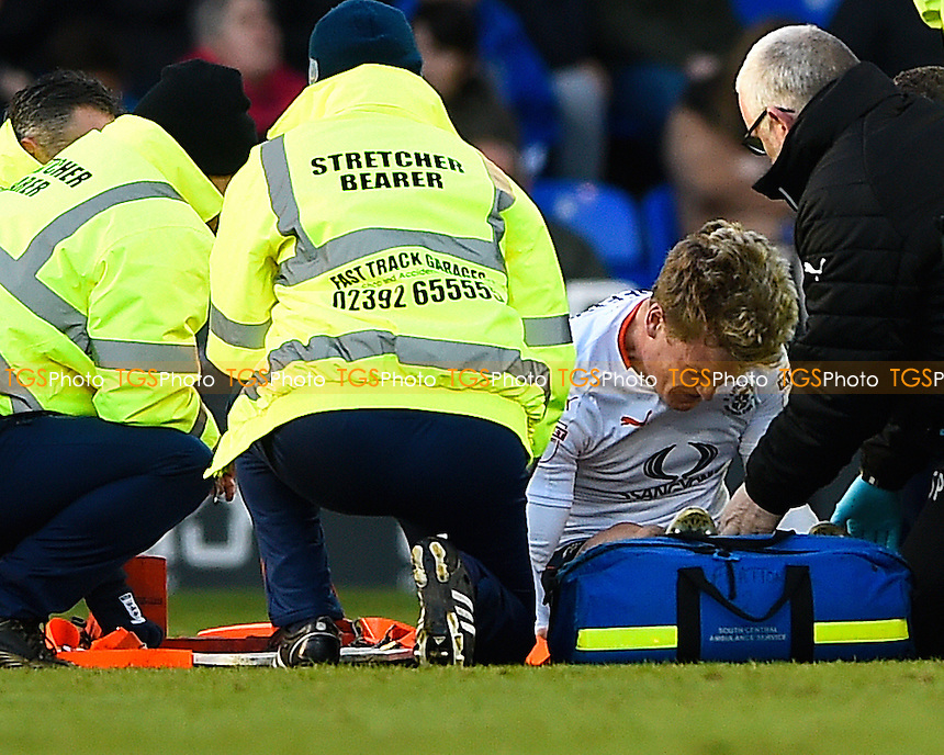 Cameron McGeehan of Luton Town bangs the ground in pain as he is treated for a broken leg  during Portsmouth vs Luton Town, Sky Bet EFL League 2 Football at Fratton Park on 2nd January 2017