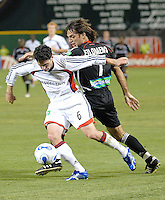 New England Revolution Jay Heaps fighting to keep control of the ball against DC United forward Lucio Filomeno. DC United defeated the New England Revolution 1-0 at RFK Stadium, Washington DC, June 3, 2006.