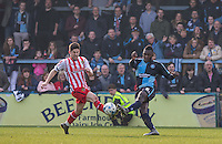 Aaron Pierre of Wycombe Wanderers & Tom Pett of Stevenage go in for the ball during the Sky Bet League 2 match between Wycombe Wanderers and Stevenage at Adams Park, High Wycombe, England on 12 March 2016. Photo by Andy Rowland/PRiME Media Images.