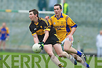 Daithi Casey (Dr Crokes) gets the ball away from Brian McGuire (Feale Rangers) in their County Championship Semi-final at Austin Stack park on Sunday.