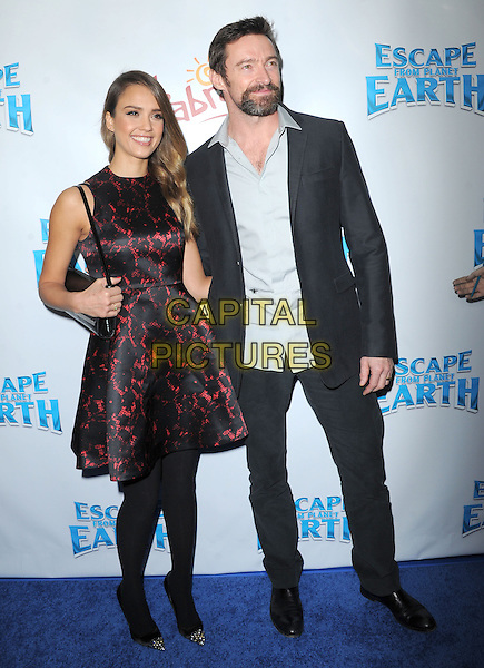 Jessica Alba & Hugh Jackman .at Weinstein Company L.A. Premiere of 'Escape from Planet Earth' held at The Chinese 6 Theater in Hollywood, California, USA, February 2nd 2013.                                                               .full length  red black print dress   sleeveless strap shoulder bag tights toe cap pointed shoes grey gray suit white shirt arm around .CAP/DVS.©Debbie VanStory/Capital Pictures.