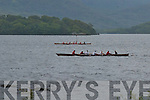 Crews battle opponents and the weather conditions at the.Killarney Regatta at OMahonys Point last Sunday.