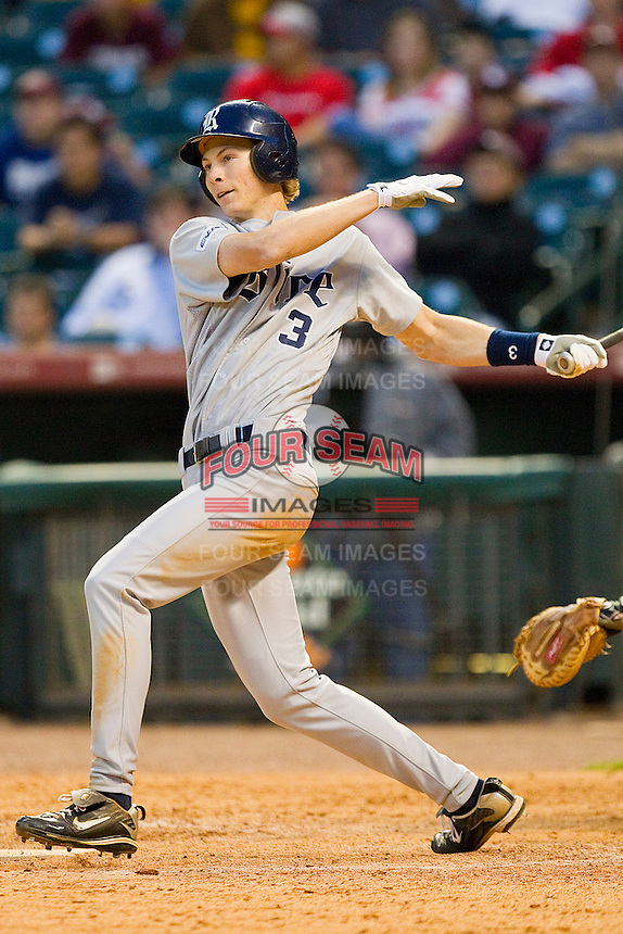 Jeremy Rathjen #3 of the Rice Owls follows through on his swing against the Baylor Bears at Minute Maid Park on March 6, 2011 in Houston, Texas.  Photo by Brian Westerholt / Four Seam Images