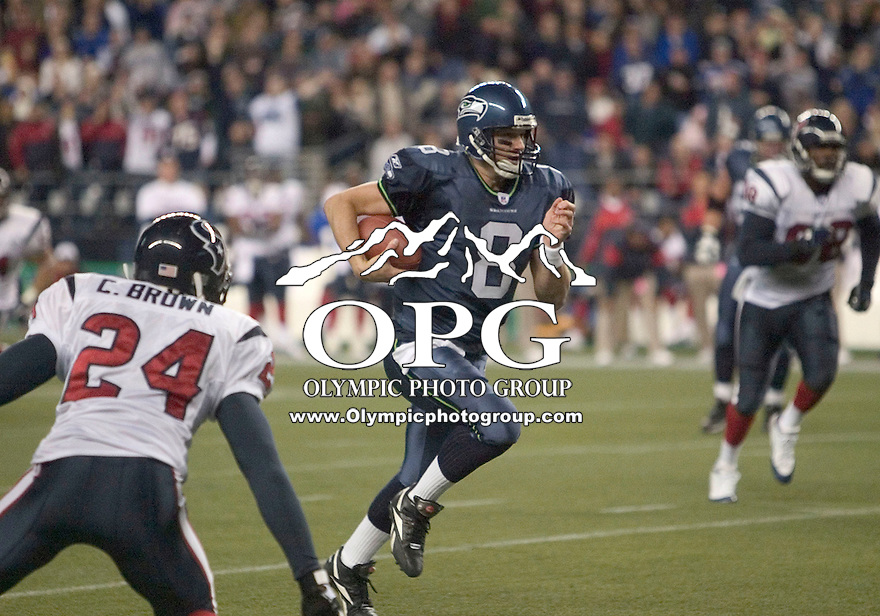 October 16, 2005:   Seattle Seahawks  quarterback Matt Hasselbeck scrambled up field for a first down against the Houston Texans at Quest Field in Seattle, WA.