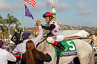 DEL MAR, CA - NOVEMBER 04: John Velazquez, aboard World Approval #5, is congratulated after winning the Breeders' Cup Mile race on Day 2 of the 2017 Breeders' Cup World Championships at Del Mar Racing Club on November 4, 2017 in Del Mar, California. (Photo by Sue Kawczynski/Eclipse Sportswire/Breeders Cup)