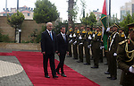"Palestinian prime minister Rami Hamdallah and French Prime Minister Manuel Valls inspect the honor guard in the West Bank city of Ramallah, on May 24, 2016. Palestinian prime minister Rami Hamdallah dismissed an Israeli proposal for direct negotiations instead of a French multilateral peace initiative, calling it an attempt to ""buy time"". Photo by Shadi Hatem"