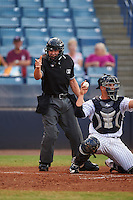 Umpire Jonathan Parra calls a strike as catcher Wes Wilson throws the ball back to the pitcher during a game between the Daytona Tortugas and Tampa Yankees on August 5, 2016 at George M. Steinbrenner Field in Tampa, Florida.  Tampa defeated Daytona 7-1.  (Mike Janes/Four Seam Images)