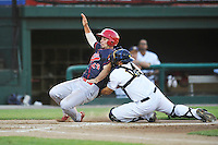 Peoria Chiefs Dylan Becker (43) is tagged out at home plate by Burlington's Webster Rivas (14) during the game against the Bees at Community Field on June 9, 2016 in Burlington, Iowa.  Peoria won 6-4.  (Dennis Hubbard/Four Seam Images)