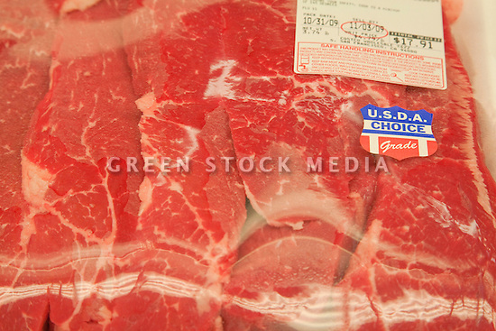 A close-up of packaged meat beef with a USDA Choice Grade Beef sticker (USDA = United States Department of Agriculture).