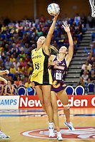 Irene van Dyk ( Pulse ) and Laura Geitz ( Firebirds ) in action during the ANZ Championship - Mojo Pulse v Queensland Firebirds at Te Rauparaha Arena, Porirua, New Zealand on Sunday 8 March 2015. <br /> Photo by Masanori Udagawa. <br /> www.photowellington.photoshelter.com.