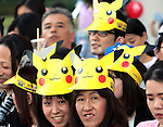 "August 7, 2016, Yokohama, Japan - People wearing hats of  Pikachu characters, Nintendo's videogame software Pokemon's wellknown character, parade at a street in Yokohama, suburban Tokyo on Sunday, August 7, 2016. The Pikachu mascots walk around the shoppjng mall daily to attract summer vacationers as a part of the ""Great Pikachu Outbreak"" event through August 14.    (Photo by Yoshio Tsunoda/AFLO) LWX -ytd-"