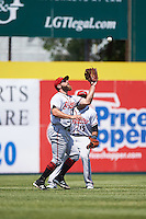 Richmond Flying Squirrels left fielder Tyler Horan (31) catches a fly ball as Darren Ford (15) backs up the play during a game against the Binghamton Mets on June 26, 2016 at NYSEG Stadium in Binghamton, New York.  Binghamton defeated Richmond 7-2.  (Mike Janes/Four Seam Images)