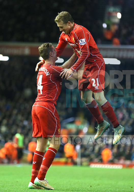 Jordan Henderson of Liverpool and Lucas Leiva of Liverpool celebrate the own goal  - Barclays Premier League - Liverpool vs Swansea City - Anfield Stadium - Liverpool - England - 29th December 2014  - Picture Simon Bellis/Sportimage