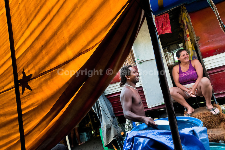 Anny, the owner of the circus, sits in the door of her caravan at the Circo Anny, a family run circus wandering the Amazon region of Ecuador, 4 July 2010. The Circo Anny circus belongs to the old-fashioned traveling circuses with a usual mixture of acrobat, clown and comic acts. Due to the general loss of popularity caused by modern forms of entertainment such as movies, TV shows or internet, these small family enterprises balance on the edge of survival. Circuses were pushed away and now they have to set up their shows in more remote villages. The circus art and culture is slowly dying.