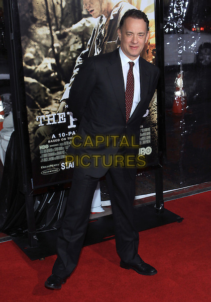 "TOM HANKS .Attending the Los Angeles Premiere of HBO's ""The Pacific"" held at Grauman's Chinese Theater, Hollywood, California, USA, 24th February 2010 .full length black suit white shirt red polka dot tie .CAP/ADM/TC.©T. Conrad/AdMedia/Capital Pictures."