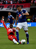 BOGOTÁ - COLOMBIA, 20-01-2019: Carlos Arboleda (Izq.) jugador de Independiente Santa Fe disputa el balón con Felipe Jaramillo (Der.) jugador de Millonarios, durante partido Independiente Santa Fe y Millonarios, por el Torneo Fox Sports 2019, jugado en el estadio Nemesio Camacho El Campin de la ciudad de Bogotá. / Carlos Arboleda (L) player of Independiente Santa Fe vies for the ball with Felipe Jaramillo (R) player of Millonarios, during a match between Independiente Santa Fe and Millonarios, for the Fox Sports Tournament 2019, played at the Nemesio Camacho El Campin stadium in the city of Bogota. Photo: VizzorImage / Luis Ramírez / Staff.