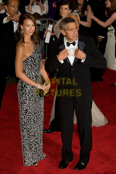"SARAH LARSON & GEORGE CLOONEY.Costume Institute Gala - ""Superheroes: Fashion and Fantasy"" at The Metropolitan Museum of Art, New York, NY, USA..May 5th, 2008 .full length grey gray one shoulder pattern dress tuxedo black posing funny couple.CAP/LNC.©TOM/LNC/Capital Pictures."