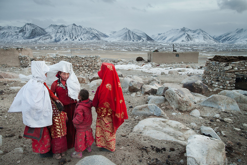 Taking a rare break in their day, women gossip at the Khan's camp. The origin of the word Kyrgyz is believed by scholars and Kyrgyz alike to derive from two words - kyrk (forty) kyz (maidens) - a reference to the mythical progenitors of the Kyrgyz people..At the Qyzyl Qorum camp. It is the camp of the now deceased Khan (Abdul Rashid Khan, died in December 2009), and headed by the self proclaimed young Haji Roshan Khan (his son). Opium addicted Haji Roshan was never officially stated Khan and is therefore not accepted as leader by the entire Kyrgyz community. Near the Afghan-China border...Trekking through the high altitude plateau of the Little Pamir mountains, where the Afghan Kyrgyz community live all year, on the borders of China, Tajikistan and Pakistan.