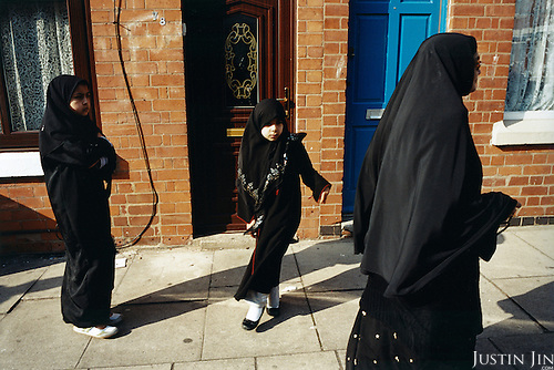 Amirah Hajat (L), 10, and her cousin Zara, 6, follow their grandma Amina, 67, to their madrassa (koran school) after their regular school. Amirah, a third-generation British Muslim, says she rates playing football far above the Koran school. ..Leicester is expected to be the first city in the UK to have a majority non-white population within the next few years. It is one of the most ethnically-diverse cities in Europe. ....Picture taken April 2005 by Justin Jin