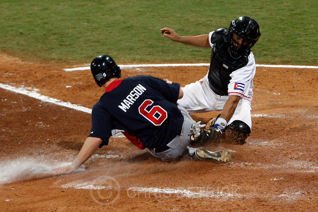USA's Lou Marson slides safely into home base past Cuba's Ariel Pestano during the semifinals game at the Wukesong Baseball Field in Beijing, Friday, August 22, 2008.  Cuba won the game 10-2..Chris Detrick/The Salt Lake Tribune.
