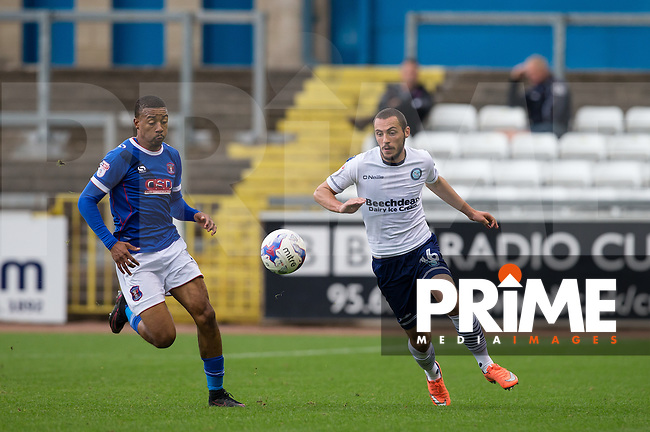 Michael Harriman of Wycombe Wanderers & Reggie Lambe of Carlisle United during the Sky Bet League 2 match between Carlisle United and Wycombe Wanderers at Brunton Park, Carlisle, England on 24 September 2016. Photo by Andy Rowland.