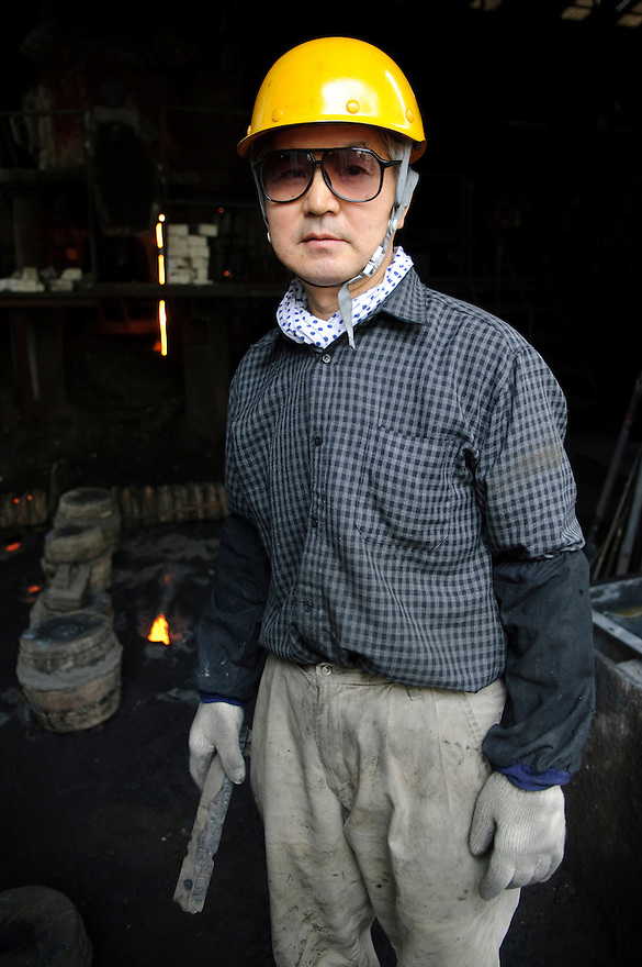 "A worker at Oigen ""Nambu Tekki"" ironware foundry, Esashi, Iwate Prefecture, Japan, August 28 2008."