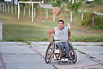 Manuel Rios pushes his wheelchair forward toward the basketball during practice in Zipolite, a town in Oaxaca, Mexico. Rios plays on the Oaxaca Costa wheelchair basketball team.