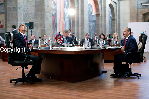 President Barack Obama, looks up at the ceiling of the Cabanas Cultural Center during the Trilateral meeting with Canada's Prime Minister Stephen Harper and Mexico's President Felipe Calderon at the North American Leaders' Summit in Guadalajara, Mexico, August 10, 2009.  (Official White House Photo by Pete Souza)<br /> <br /> This official White House photograph is being made available only for publication by news organizations and/or for personal use printing by the subject(s) of the photograph. The photograph may not be manipulated in any way and may not be used in commercial or political materials, advertisements, emails, products, promotions that in any way suggests approval or endorsement of the President, the First Family, or the White House.