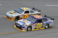 May 1, 2009; Richmond, VA, USA; NASCAR Sprint Cup Series driver David Reutimann (00) races alongside David Ragan (6) during practice for the Russ Friedman 400 at the Richmond International Raceway. Mandatory Credit: Mark J. Rebilas-