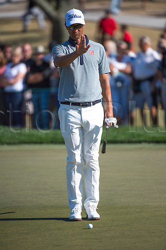 27.02.2016. Palm Beach, Florida, USA.  Adam Scott lines up a putt during the third round of the Honda Classic at the PGA National Resort & Spa in Palm Beach Gardens, FL.