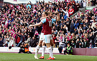 Chris Wood celebrates scoring his sides second goal with team-mate Charlie Taylor<br /> <br /> Photographer Rich Linley/CameraSport<br /> <br /> The Premier League - Saturday 13th April 2019 - Burnley v Cardiff City - Turf Moor - Burnley<br /> <br /> World Copyright © 2019 CameraSport. All rights reserved. 43 Linden Ave. Countesthorpe. Leicester. England. LE8 5PG - Tel: +44 (0) 116 277 4147 - admin@camerasport.com - www.camerasport.com