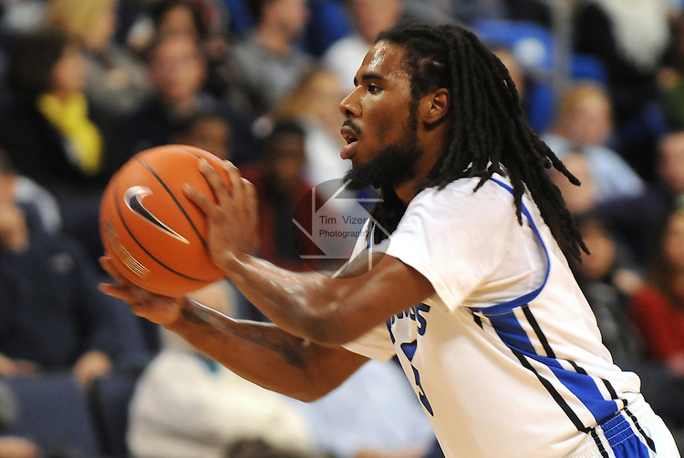 Saint Louis Billikens guard Jordair Jett (5) passes in second-half action during a non-conference game between the St. Louis University Billikens and the Southern Illinois University-Carbondale Salukis on November 24, 2012 at the Chaifetz Arena in St. Louis Missouri.  The Billikens won, 61-51.