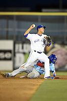 Dunedin Blue Jays second baseman Christian Lopes (14) attempts to turn a double play during a game against the Daytona Cubs on April 14, 2014 at Florida Auto Exchange Stadium in Dunedin, Florida.  Dunedin defeated Daytona 1-0  (Mike Janes/Four Seam Images)