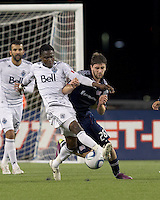Vancouver Whitecaps FC midfielder Gershon Koffie (28) and New England Revolution midfielder Stephen McCarthy (26) battle for the ball. In a Major League Soccer (MLS) match, the New England Revolution defeated the Vancouver Whitecaps FC, 1-0, at Gillette Stadium on May14, 2011.