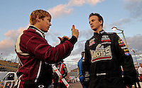 Nov. 13, 2009; Avondale, AZ, USA; NASCAR Camping World Truck Series driver Brad Sweet (left) talks with Tayler Malsam during the Lucas Oil 150 at Phoenix International Raceway. Mandatory Credit: Mark J. Rebilas-