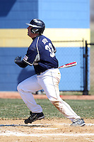 Genesee Community College Cougars first baseman Bryan Depew #32 hits a home run during a game against the Ithaca JV team at Genesee Community College on April 9, 2011 in Batavia, New York.  Photo By Mike Janes/Four Seam Images