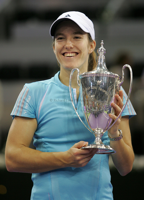 Photo: Cesar Cebolla..Sony Ericsson Championship Final. 12/11/2006.Amelie Moresmo (FRA) v  Justinne Henin-Hardene (BEL)..Justinne Henin-Hardene with the trophy after winning the final.