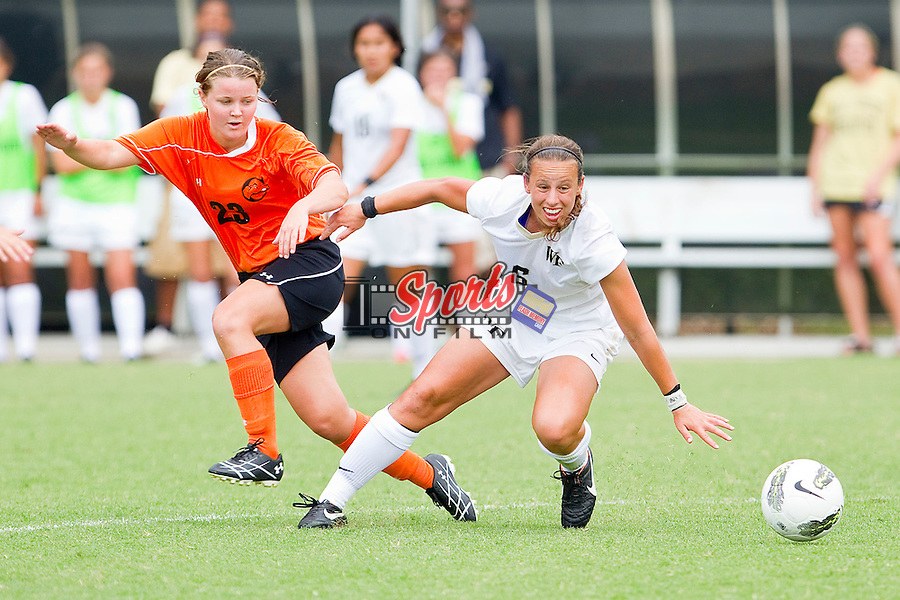 Jackie McSally #6 of the Wake Forest Demon Deacons battles for a loose ball with Line Berntsen #23 of the Campbell Camels at Spry Soccer Stadium on September 4, 2011 in Winston-Salem, North Carolina.  The Demon Deacons defeated the Camels 3-0.  (Brian Westerholt / Sports On Film)