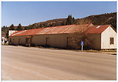 Side and end view of Dolores farm implement warehouse.<br /> Dolores, CO