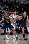 Troy Rike (45) of the Wake Forest Demon Deacons is boxed out by John Mooney (33) and Rex Pflueger (0) of the Notre Dame Fighting Irish during first half action at the LJVM Coliseum on February 24, 2018 in Winston-Salem, North Carolina. The Fighting Irish defeated the Demon Deacons 76-71.  (Brian Westerholt/Sports On Film)